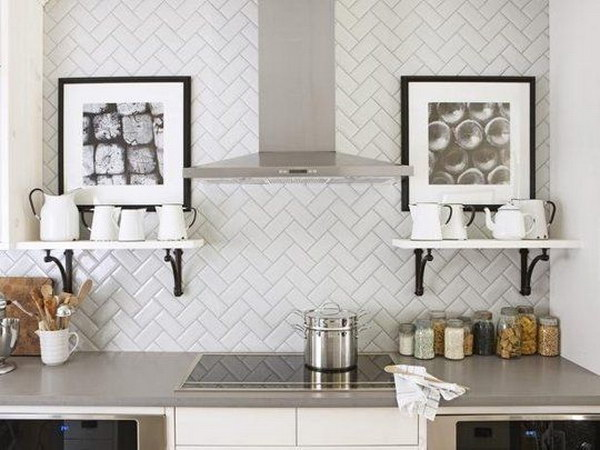 White Herringbone Subway Tile Backsplash Teams With Grey Countertops