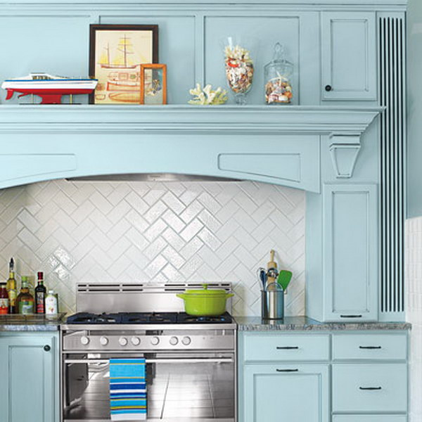 Subway Tiles Backsplash in a Herringbone Pattern with Blue Cabinets