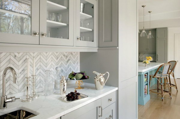 Marble Tiled Chevron Backsplash With Light Grey Cabinetry 27 Kitchen Backsplash Ideas
