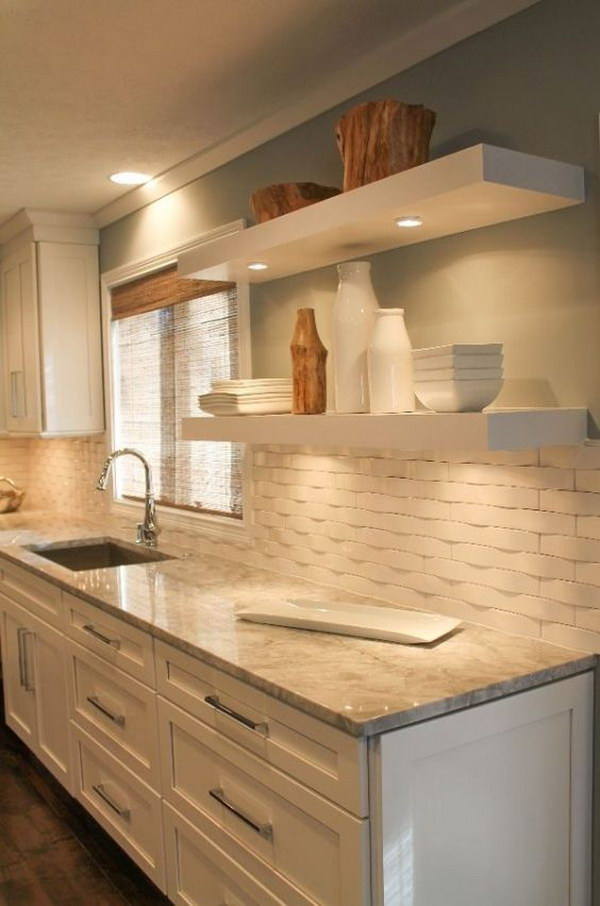 chevron tile backsplash in a stylish kitchen with contrasting cabinets