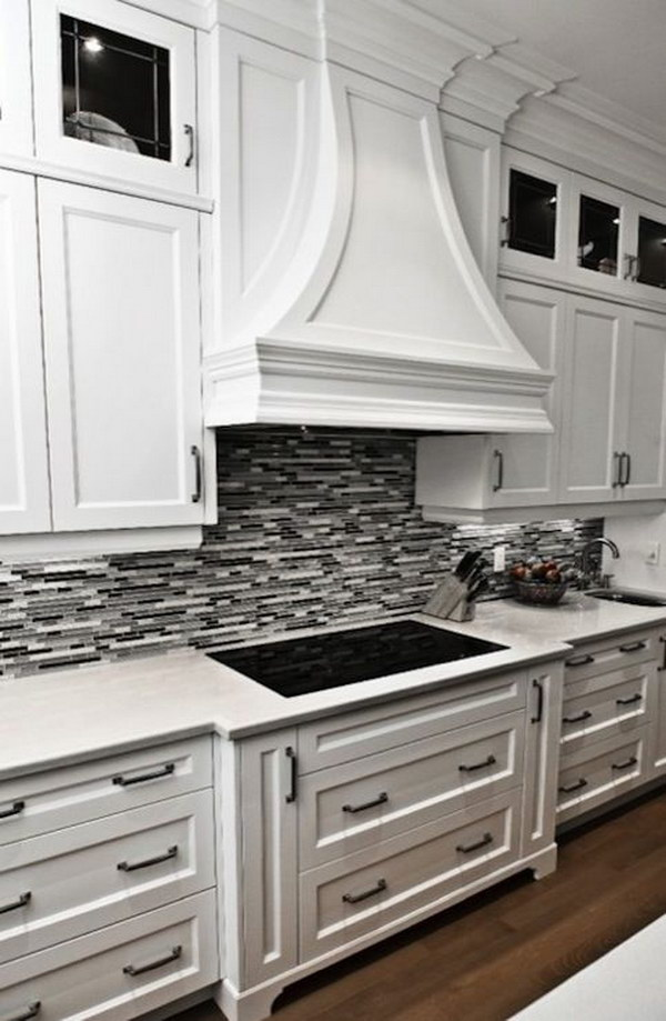 Charming Black Or Grey Linear Glass Tile Backsplash With Crisp White Cabinetry And  Marble Countertops