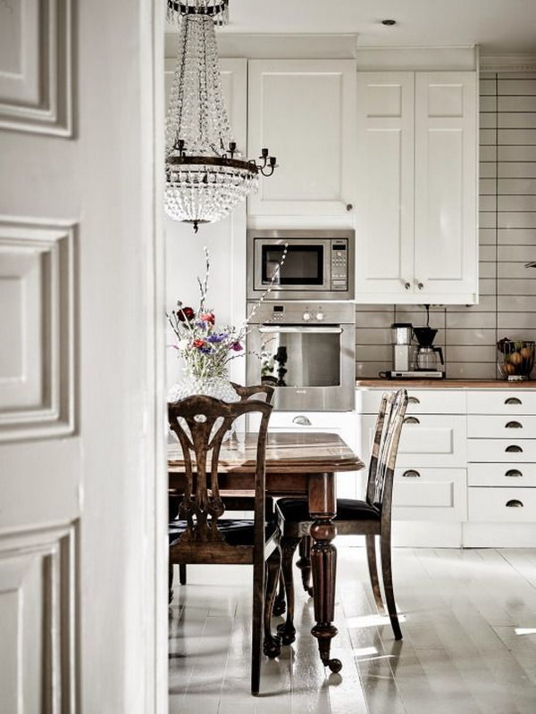 White Subway Tile Backsplash and Black Grout in a Classic White Grey and Black Kitchen