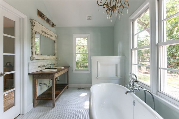 Farmhouse Bathroom With Chandelier Over Tub.