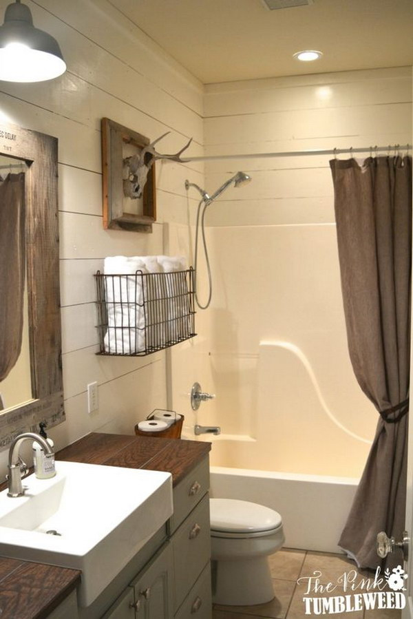 Rustic Bathroom With Wire Towel Basket Over The Toilet
