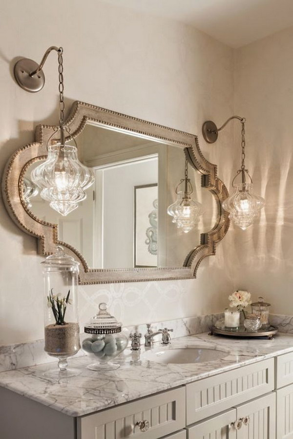 Rustic Pendant Lamps and the Uniquely Shaped Mirror.