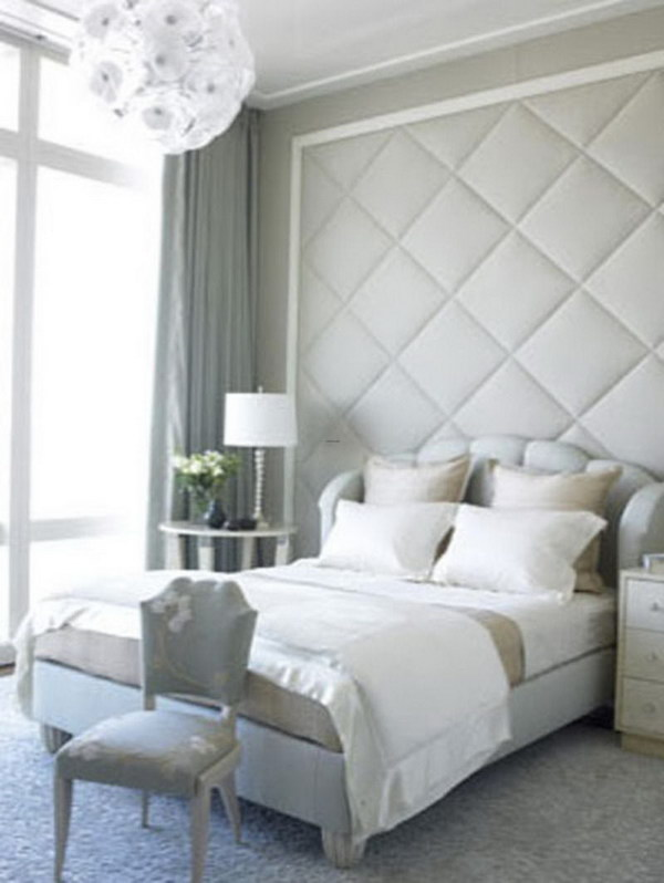 create a focal point with floor to ceiling headboard - Making A Small Bedroom Look Bigger