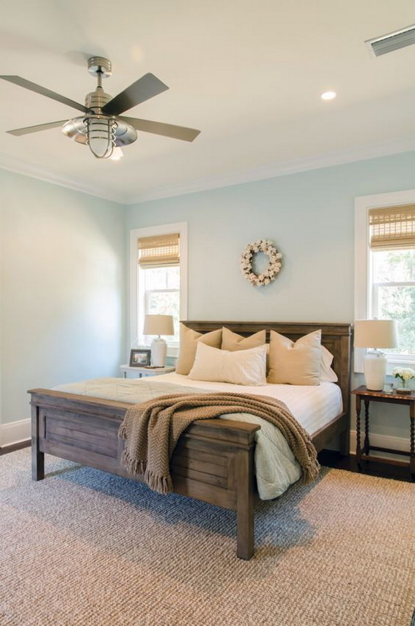 walls curtains and headboard make this small gray bedroom look bigger