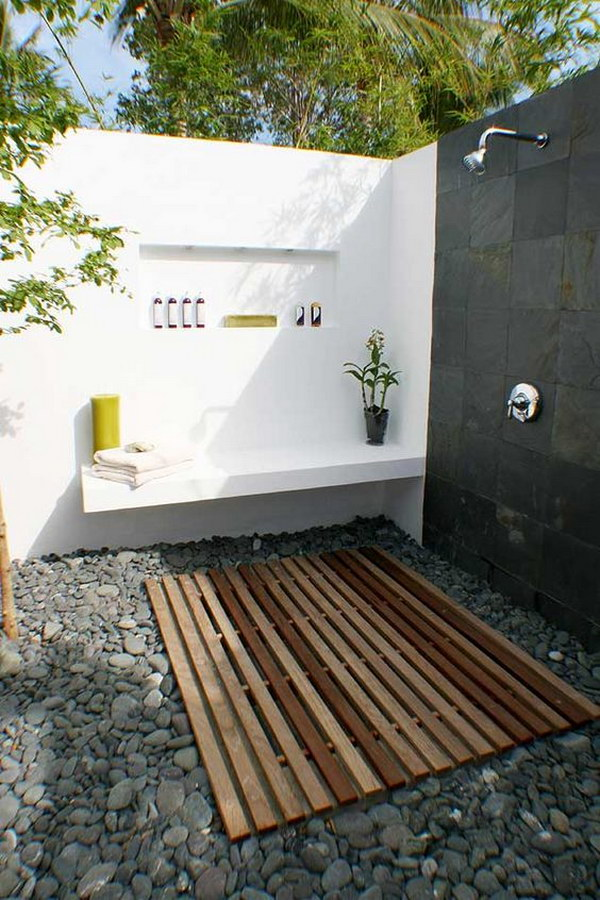 Attractive Outdoor Shower Ideas Part - 10: Natural Cobbles Covered Outdoor Shower Area With Wall Mounted Bench