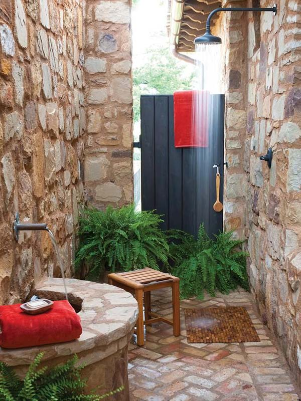 Stone Walled Outdoor Shower With Wood Stool