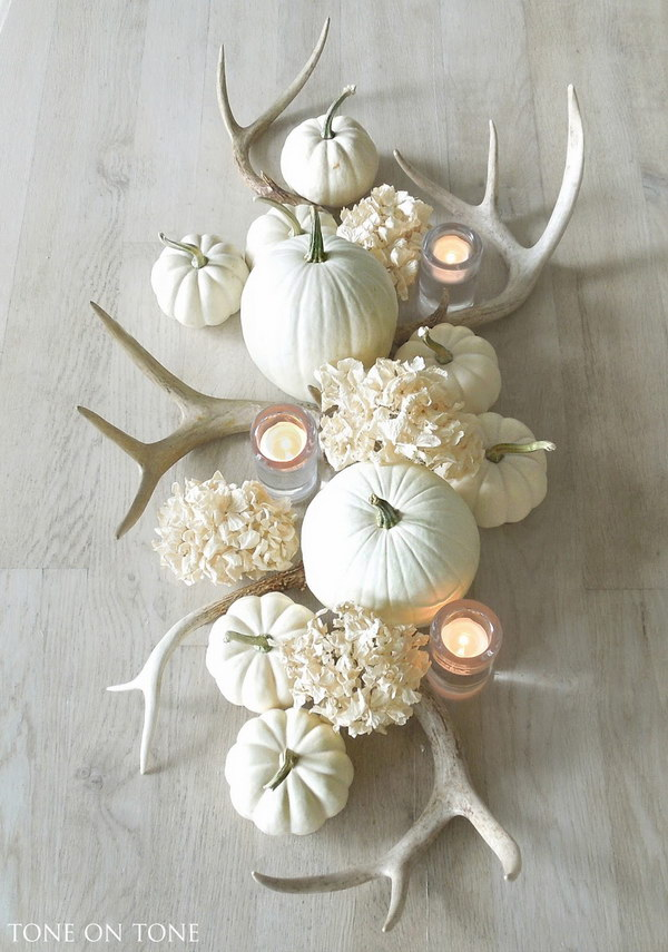 Stunning Fall Centerpiece with Antlers, Pumpkins, and Hydrangeas.