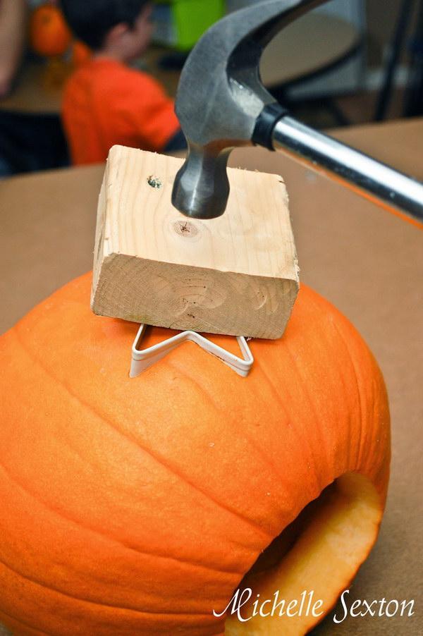 Carving a Pumpkin Using a Cookie Cutter.