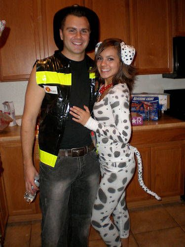 Firefighter and a Dalmatian.