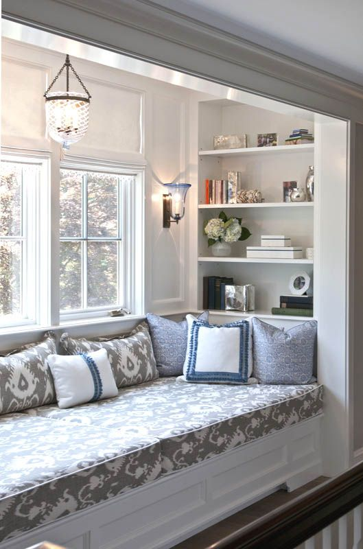 Make a Reading Nook With Shelving on Your Bay Window Seating.