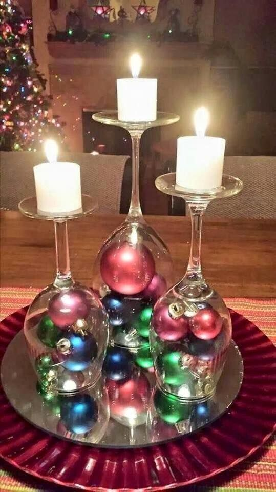 diy upside down wine glasses with small christmas ornaments in bottom and candles on top