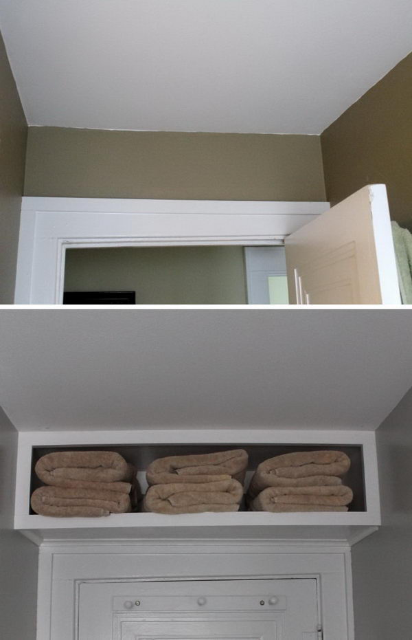 Make use of wasted space above the door with a shelf.