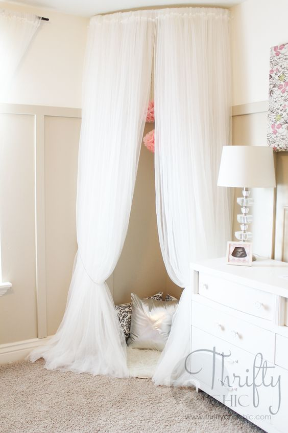 DIY Whimsical Canopy Tent or Reading Nook Made From Curved Curtain Rod And $4 Ikea Curtains.