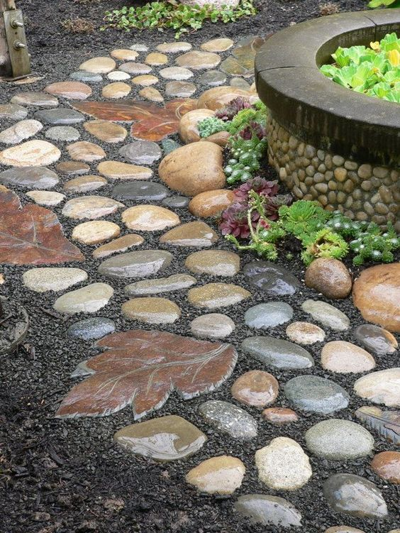 Garden Pathway Made Of Rocks And The Stepping Stone Made From A Leaf Mold