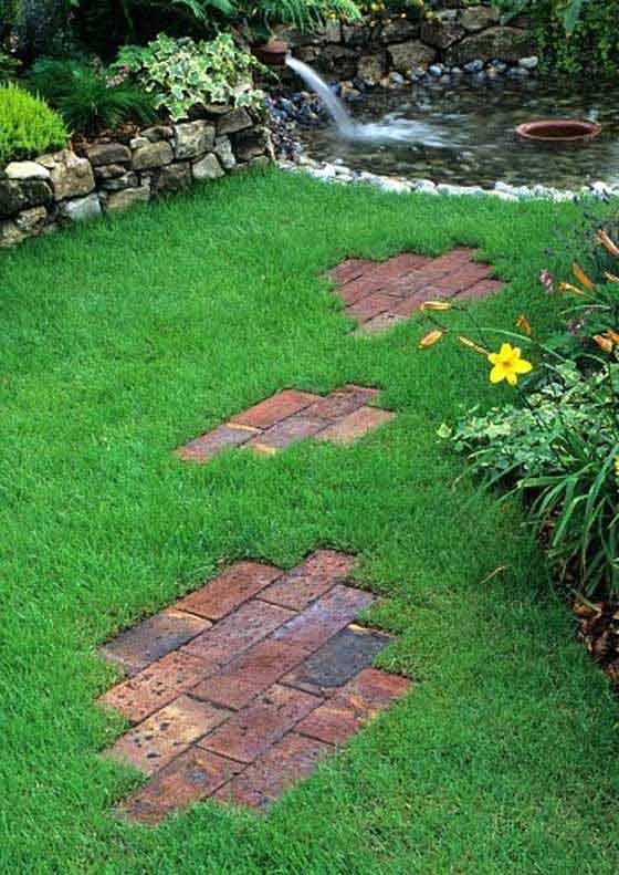 Decorative Brick Path Across Lawn .