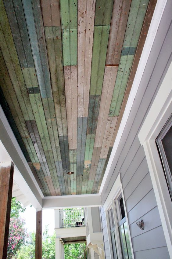 Install Salvaged Beadboard on the Porch Ceiling.