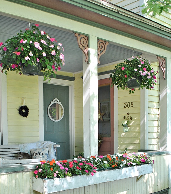 Create an Inviting Front Porch with Hanging Baskets and Flower Boxes.