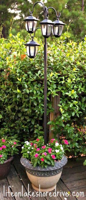 Make a Solar Light Lamp Post with Flower Planter.