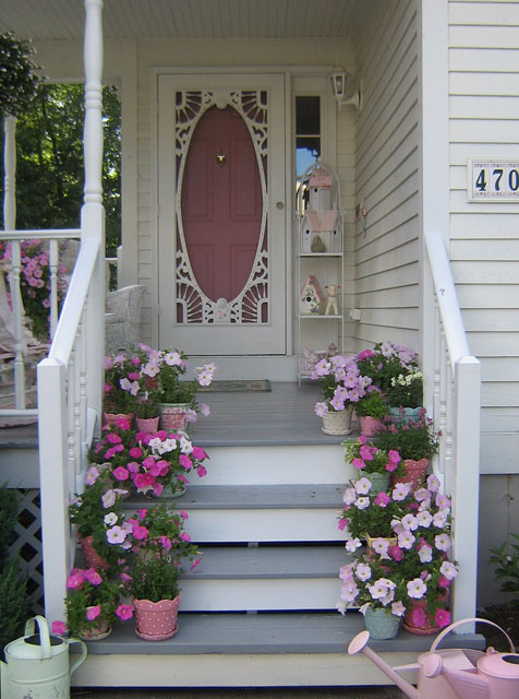 Display Potted Flowers on Your Porch Steps.