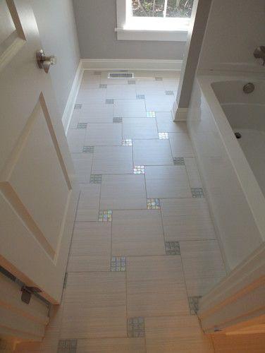Bathroom Floor With Mosaic Inlays.
