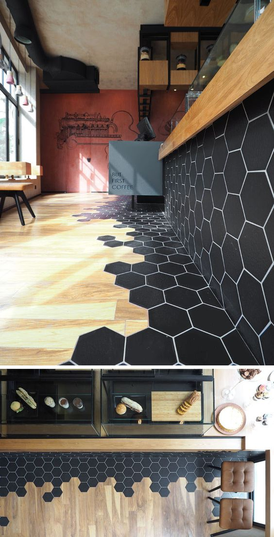 Black Hexagon Tiles Transition Into Wood Flooring.