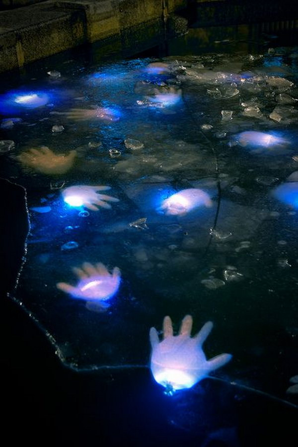 DIY Water Hands Using Glow Sticks And Latex Gloves.