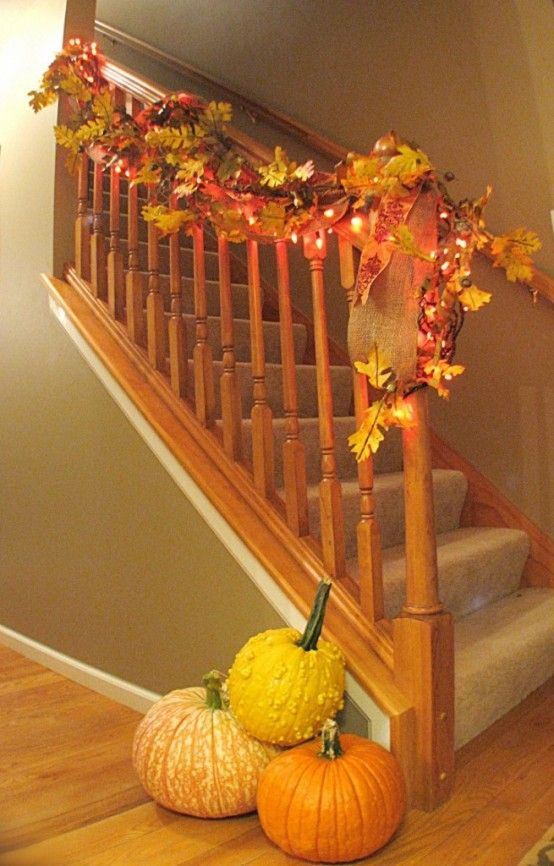 Staircase Decorated With Fall Garlands And String Lights.