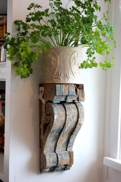 Wall Shelves Made From Old Wood Corbels For Holding Herbs.