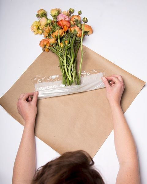 Keep A Bouquet Of Flowers Fresh With Paper Towel Wrapped In Plastic Wrap.