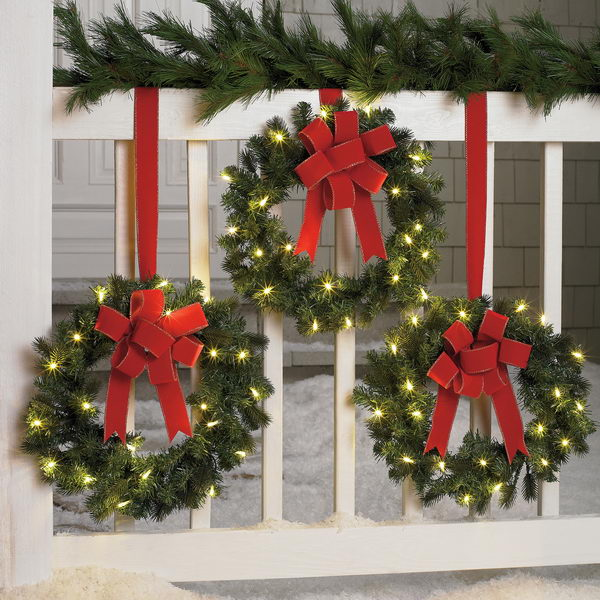 Hang Lighting Christmas Wreaths The Bautiful Way.