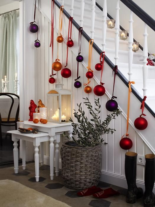 Hang Colorful Ornaments On The Stair Banister.