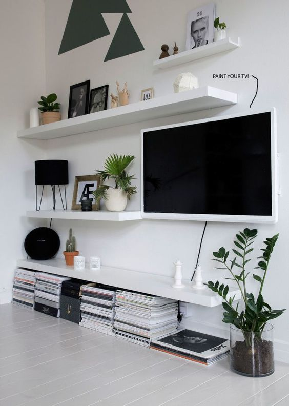 Mix TV in with Lack Ikea Shelving.