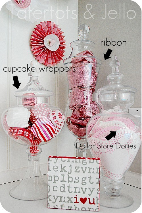 Valentine's Day Apothecary Jars With Dollar Store Doilies, Cupcake Liners And Sparkly Ribbons.