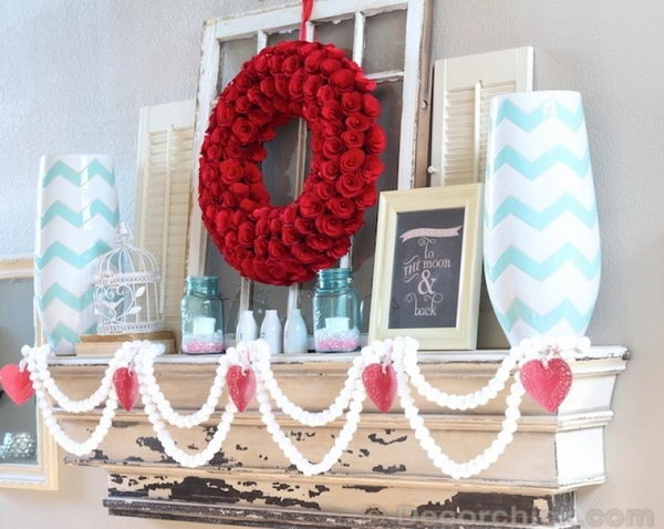 White Pom Pom Garlands And Red Rose Wreath With A Pop Of Turquoise.