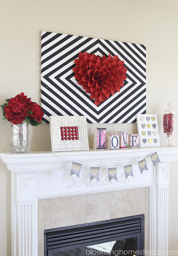 Black And White Canvas With The Red Paper Wreath In The Middle.