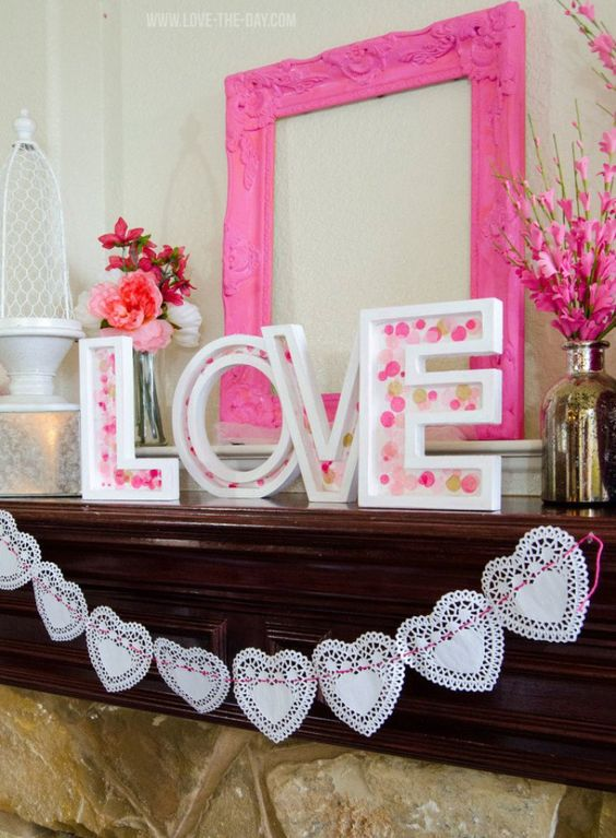 Confetti Love Letters And Doily Garland Decorated Mantel.