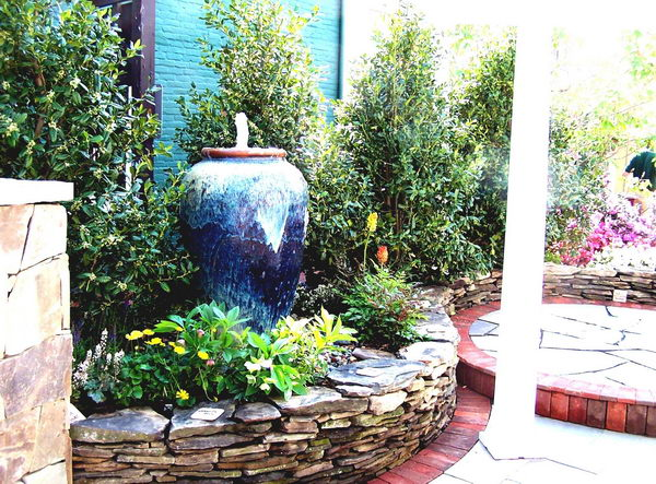 Front Yard Landscape Design With Tall Vase Fountain.